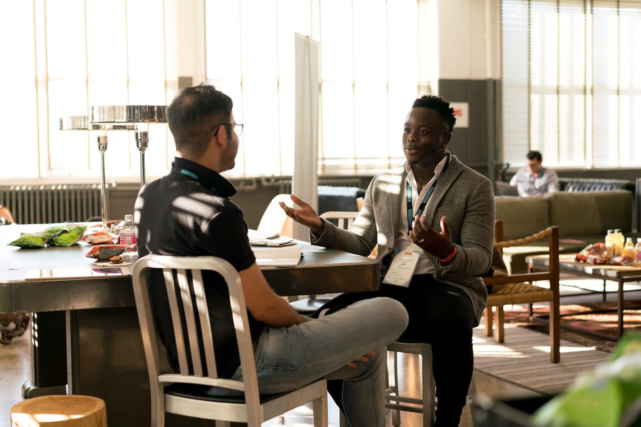 photo-of-men-having-conversation